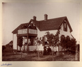 John Christoph photograph album - The Schreppel family posed with their house, Barton County, Kansas.