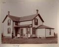 John Christoph photograph album - The Arenstorff family standing in front of their house, Barton, Kansas.