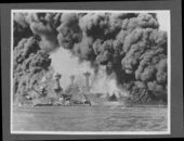 Attack on Pearl Harbor, Hawaii - USS Tennessee (background) and the USS West Virginia (foreground) are burning after the attack.