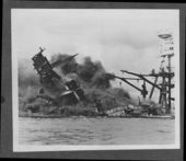 Attack on Pearl Harbor, Hawaii - USS Arizona burns after a Japanese aerial bomb went down the ship