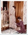 Fort Larned historic activities - Ladies hemming dress in front of mirror of officer