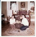 Fort Larned historic activities - Two ladies looking at album in bedroom in south officers