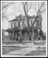 Menninger photograph collection - A photograph showing the Menninger children in front of their family home at 1251 Topeka Blvd in Topeka, Kansas, dated 1901.  Envelope C
