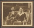 Menninger photograph collection - A photograph of Dr. C. F. and Flo Menninger seated on the yard of their house at 1251 Topeka Boulevard in Topeka, Kansas.  The photograph was taken by Karl the Sunday before he left for college at Wisconsin, circa 1912.  Envelope 6