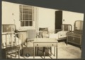 Interior views of the Security Benefit Association hospital in Topeka, Kansas - Patient room, note side rails on bed.