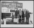 "Views of Carey Salt Company - *1 Photograph of a group of men standing in front of a sign that reads ""The Carey Rock Salt Mine"""