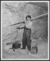 Views of Carey Salt Company - *4 Photograph of a man identified as Vernon Horton tamping dynamite inside the mine of the Carey Salt Company