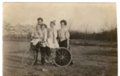 Group posed with a bicycle near Grainfield, Kansas