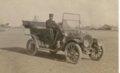 Edwin Boyer driving his Buick in Grainfield, Kansas