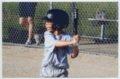 Gavin Berberich playing baseball - Batting for the Sharks team.