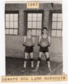 Photograph of Lecompton Basketball players Howard and Lynn McKenzie, Lecompton, Kansas - front