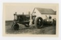 Farm children with tractor, Butler County, Kansas - front
