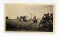 Farm family with tractor and reaper, Butler County, Kansas