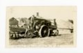 George Densberger and son with steam tractor, Butler County, Kansas - front