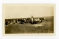 Stockman feeding cattle, Butler County, Kansas - front