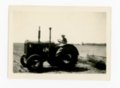 Man driving tractor, discing a field, Butler County, Kansas - front