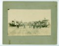 Threshing crew with machinery and hand tools, Butler County, Kansas - front