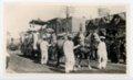 Grooms leading Butler County float, Kaffir Corn Carnival Parade, El Dorado, Butler County, Kansas - front