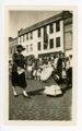 Little girl with parasol, Kaffir Corn Carnival parade, El Dorado, Butler County, Kansas - front