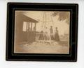Four farm women beneath a windmill, Butler County, Kansas