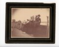 Farm family seated on an outbuilding, Butler County, Kansas