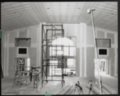 Columbian Theater, Wamego, Kansas - Renovation-theatre: View of theatre area during renovation, looking west to east. Shows Scaffold, center, ladder and table saw, left. July 1994. Photo by Richard V. Barker
