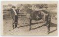 Patrick Gorman with his prized horse on his farm near Fulton, Kansas
