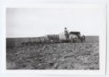 Gray tractor plowing a field, Logan County, Kansas