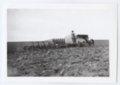 Gray tractor plowing a field, Logan County, Kansas - 1