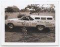Automobiles used for advertising Chicken Annie's Original restaurant, Frontenac, Kansas