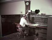 Dispatcher Lee Webster at the C.T.C. panel, Fresno, California