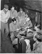 Soldiers en route to separation centers enjoying a game of cards