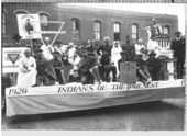 Haskell Institute students on a parade float, Lawrence, Kansas