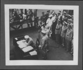 United States and Japanese officials signing the surrender document ending World War II