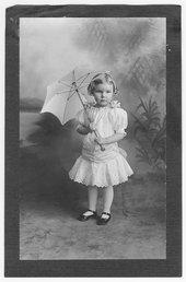 Child with an umbrella, Cimarron, Kansas