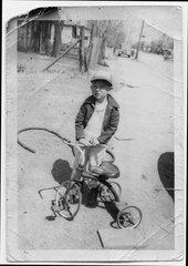 Boy with tricycle, Treece, Kansas