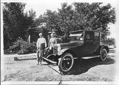 The Decker family with their automobile, Sheridan County, Kansas