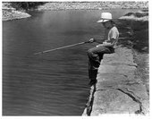 Boy fishing at Gage Park, Topeka, Kansas