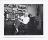 Dr. Henry B. Miller holding Shelley McClain, Rossville, Kansas
