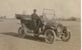 Edwin Boyer driving his Buick in Grainfield, Kansas
