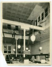 Cleaning or painting the interior of the F. W. Woolworth store in Topeka, Kansas