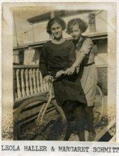Leola Haller and Margaret Schmitz on a bicycle in Alma, Kansas