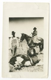 Van and Dorothea Brittingham with a roped steer or cow in Hamilton County, Kansas