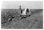 Plowing a field in Thomas County, Kansas