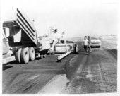Surfacing a road with asphalt, Logan County, Kansas