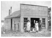 Exterior view of Roberman's Laundry, De Soto, Kansas