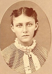 This is a portrait of Catherine (Kate) German, who was taken captive with her sisters, Sophia, Julia, and Adelaide, by Cheyenne Indians after their family was killed. On September 11, 1874, the John German family, consisting of his wife and seven children, was attacked by a band of Cheyenne east of Ft. Wallace, Kansas. Only the four youngest, Sophia, Catherine, Julia, and Adelaide, were spared and taken captive. The two youngest, Julia and Adelaide (aged 7 and 5), were subsequently abandoned on the prairie in what is now the Texas panhandle. Sophia and Catherine were kept by their Cheyenne captors. Fort Wallace received word of the killings and began the search to find the girls and to negotiate their release. They found Julia and Adelaide, who had survived on their own for 6 weeks, and on February 26, 1875, the Cheyennes released Catherine and Sophia. The two girls were reunited with their younger sisters at Ft. Leavenworth, Kansas.