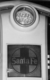 Headlight  and Santa Fe logo on locomotive