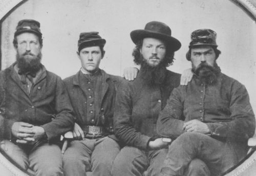 Photo of 4 soldiers in the 7th Kansas Cavalry Regiment, taken 1863