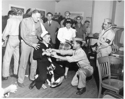Service men having fun in an USO room - Page